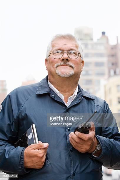 Male City Worker Standing on Metropolitan Street