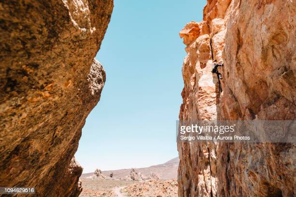 male climber challenging cliff in el teide national park, canary islands, spain - el teide national park stock pictures, royalty-free photos & images