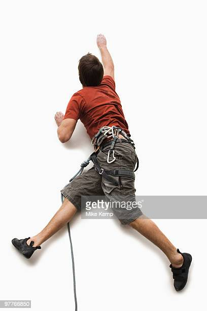 male climber - rock climbing stock pictures, royalty-free photos & images