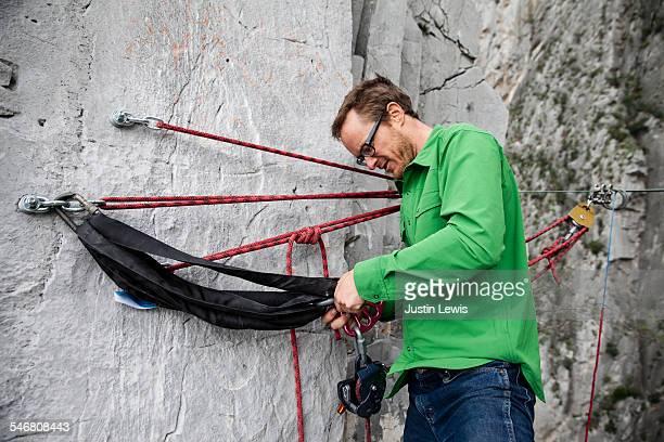 Male Climber Prepares Equipment