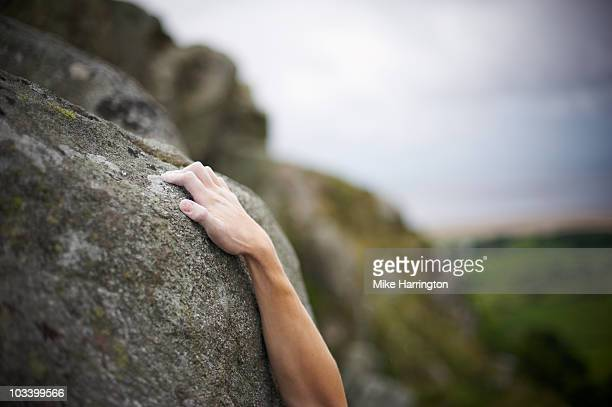 male climbing mountain face - mountaineering stock pictures, royalty-free photos & images