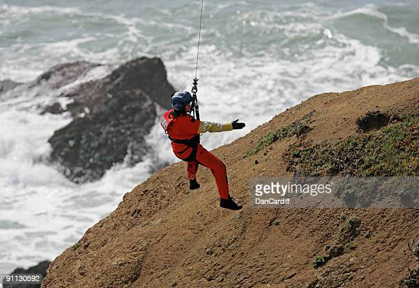 a male coast guard hanging over the ocean - coast guard stock pictures, royalty-free photos & images