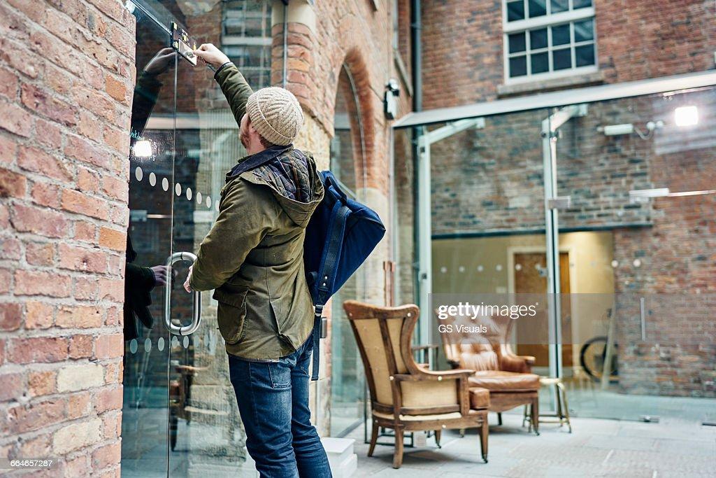 Male coffee shop owner unlocking door : Stock Photo