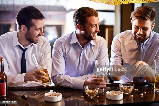 Male colleagues in bar