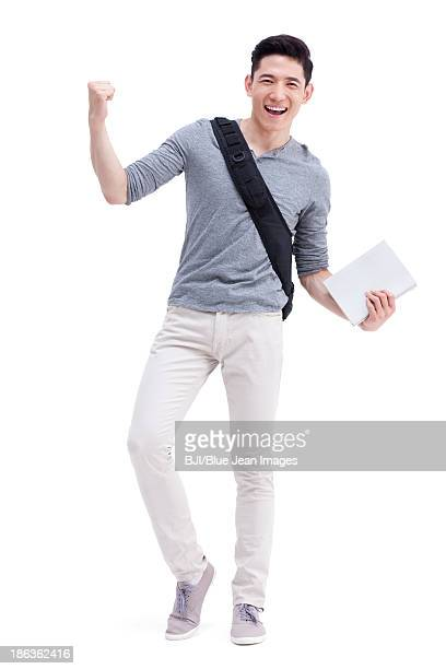 Male college student cheering