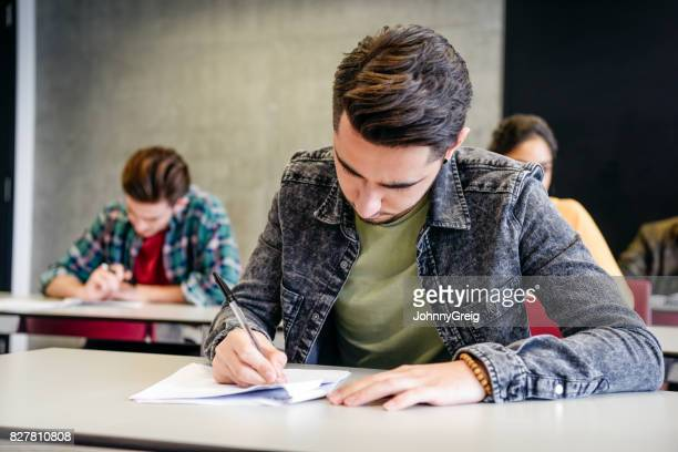 Male college student doing exam