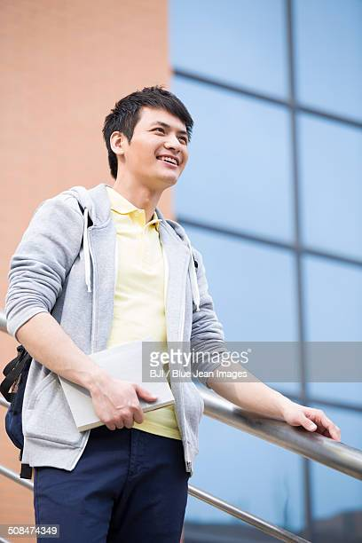 Male college student outside library
