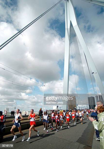 Male competitors run over the Erasmusbrug Bridge during the Rotterdam Marathon on April 4 2004 in Rotterdam Netherland