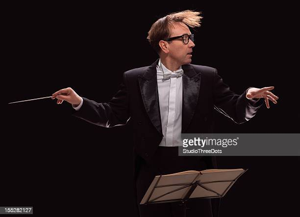 male conductor - maestro stock photos and pictures