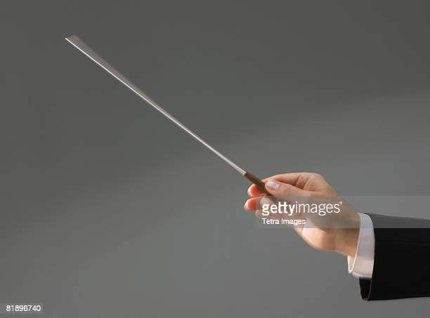 Male conductor?s hand holding baton