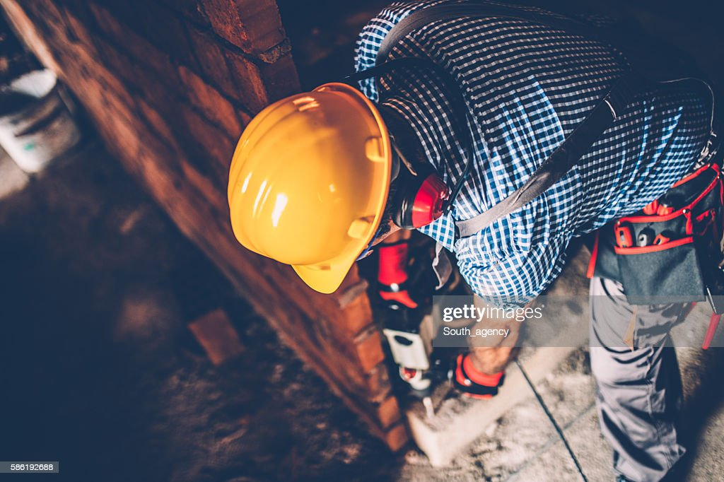 Male construction worker with a drill : Stock Photo