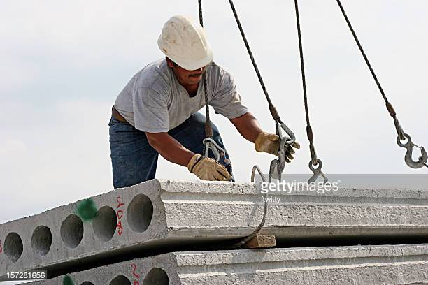 A male construction worker working with winches