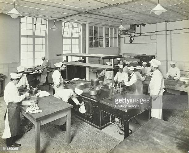 Male cookery students at work in the kitchen with a teacher supervising Westminster Technical Institute London 1910 Artist unknown