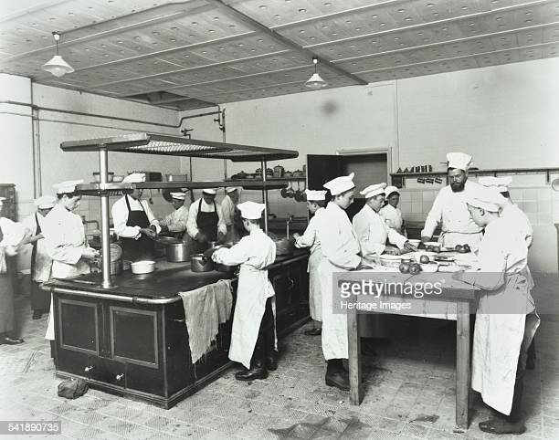 Male cookery students Westminster Technical Institute London 1910 A group of boys making pies while another group of students attend to pots and pans...