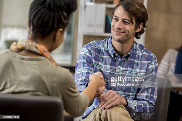 Male counselor greets new patient