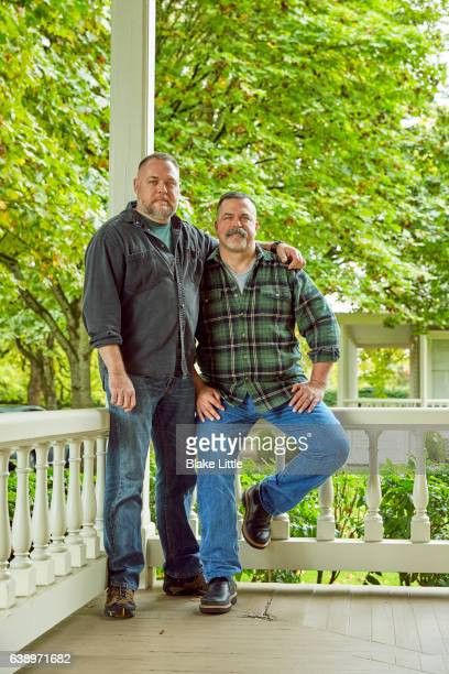 Male Couple on Porch in Embrace