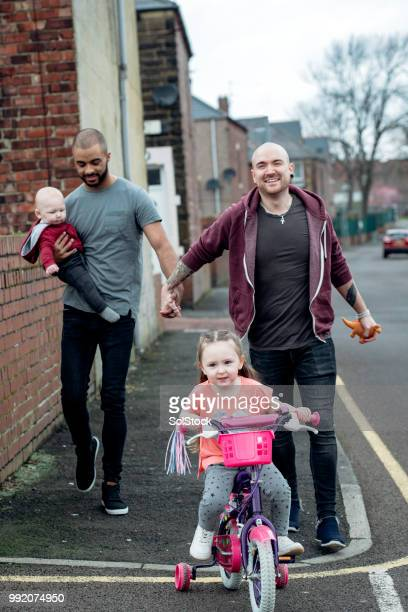 male couple out walking with the family - skinhead stock pictures, royalty-free photos & images
