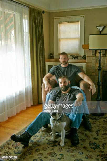 Male Couple with Bulldog at Home
