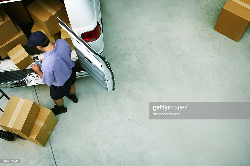 Male Courier Delivery Packages : Stock Photo