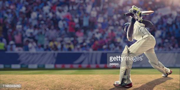 male cricket batsman having just hit ball during cricket match - cricket stock pictures, royalty-free photos & images