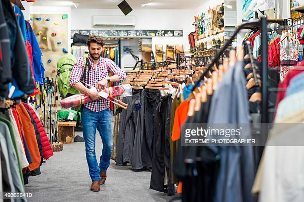 Male customer in outdoor equipment store