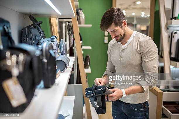 Male customer inside accessory store