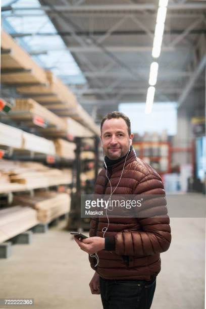 Male customer listens to musik in earphones at hardware store