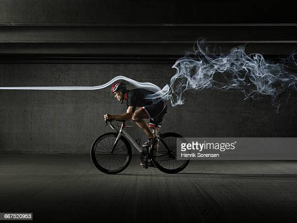 male cycling athlete in windtunnel - aerodynamic stock pictures, royalty-free photos & images