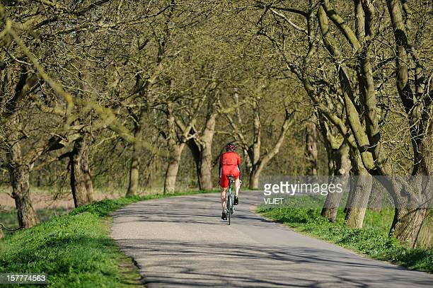 Male cyclist on a dyke road in the Netherlands