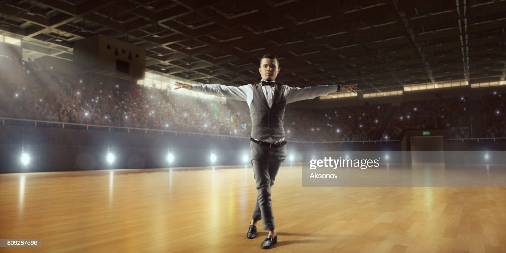 Male dancer ardently perform the latin american dance on a large professional stage : Stock Photo