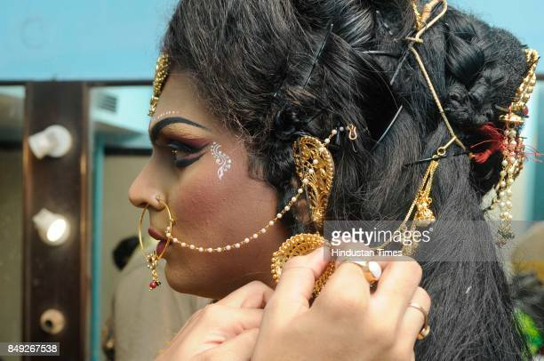 A male dancer gets ready to perform as one of the nine avatars of Durga at Gyan Mancha on September 18 2017 in Kolkata India 61 dancers of Male Dance...