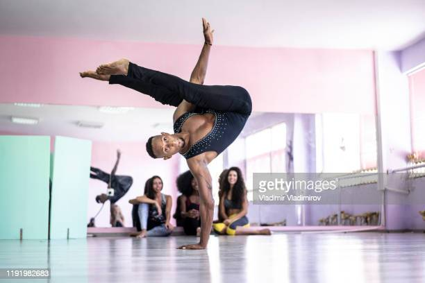 male dancer practicing in studio - rehearsal stock pictures, royalty-free photos & images