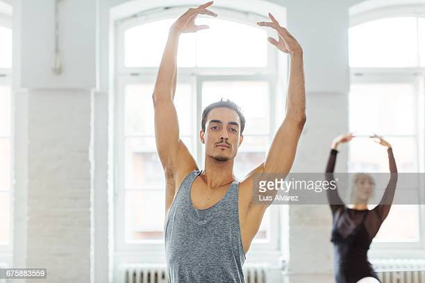 Male dancer practicing with friend at st