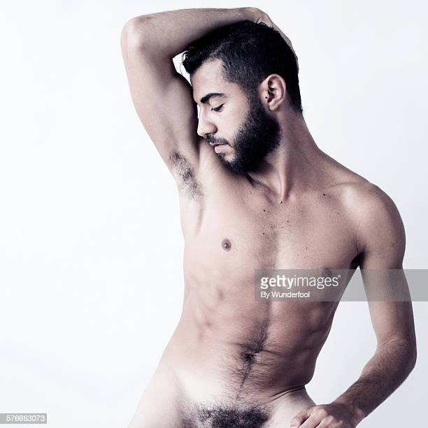 Male dancer with beard posing nude