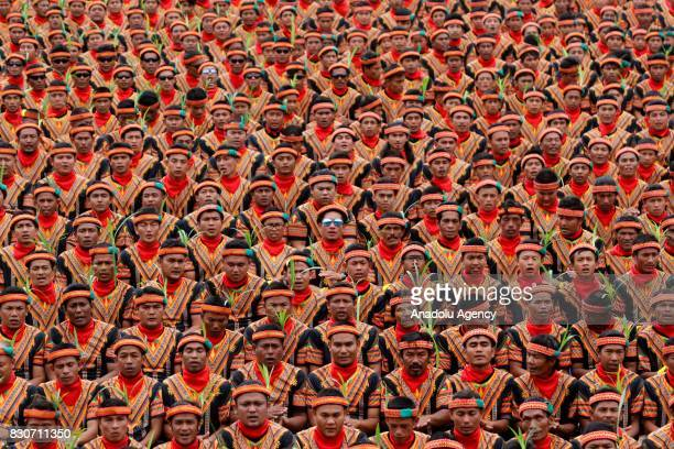 10447 male dancers perform the Saman dance one of Aceh's traditional dance at Gayo Lues Aceh Province Indonesia on August 12 2017 Saman dance is a...