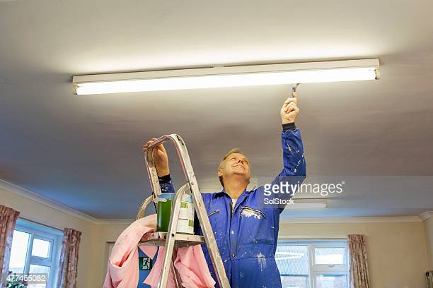 male decorator - janitor stock photos and pictures