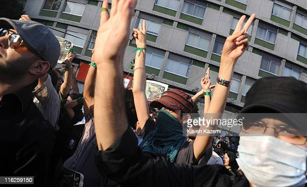 Male demonstrators wearing green ribbons in support of the Green Movement led by Mir Hossein Mousavi while marching in Vali Asr square Tehran 17th...
