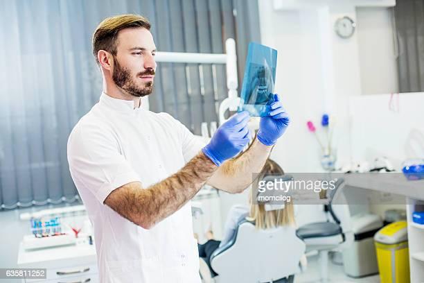 Male dentist in office