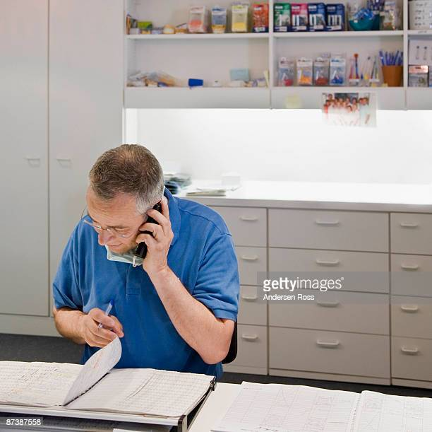 Male dentist talking on a phone