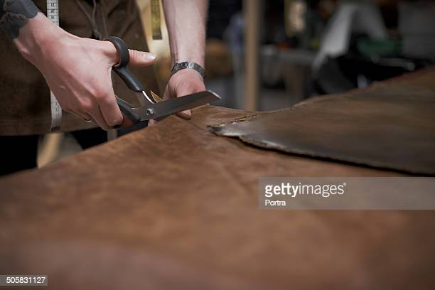 Male design professional cutting leather