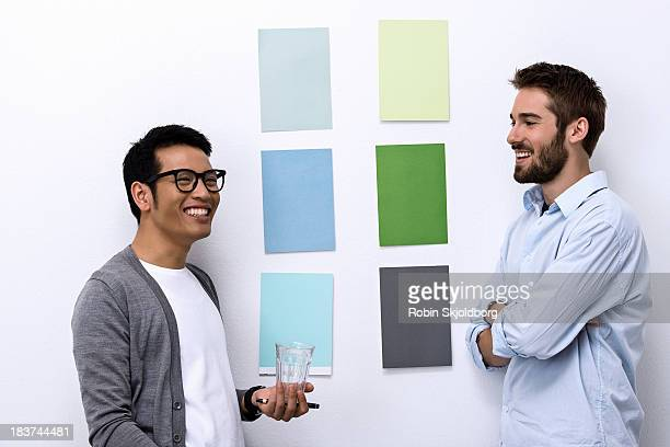 Male designers standing in front of color swatch