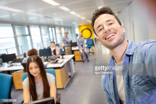 male digital designer taking selfie in office - self portrait stock pictures, royalty-free photos & images
