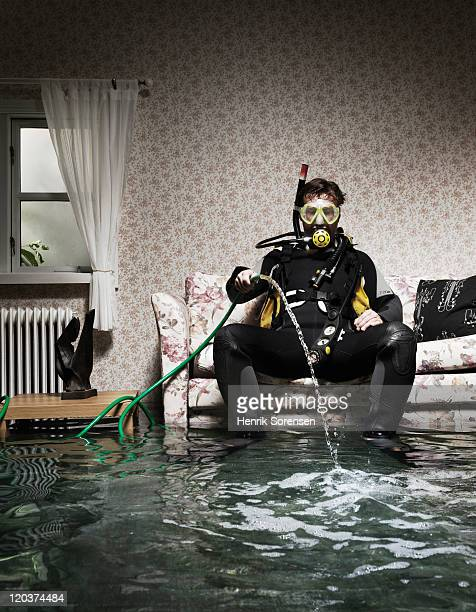 male diver in flooded room
