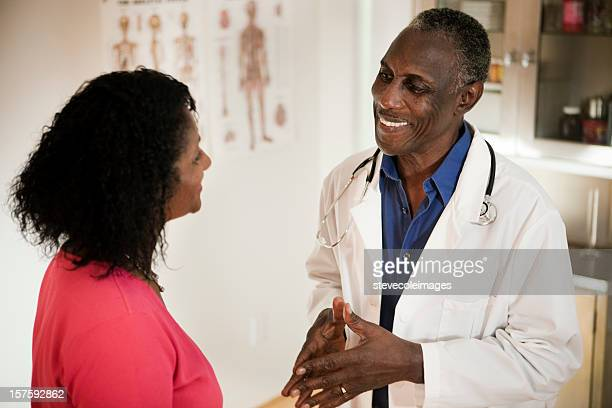 Male Doctor and Woman Patient