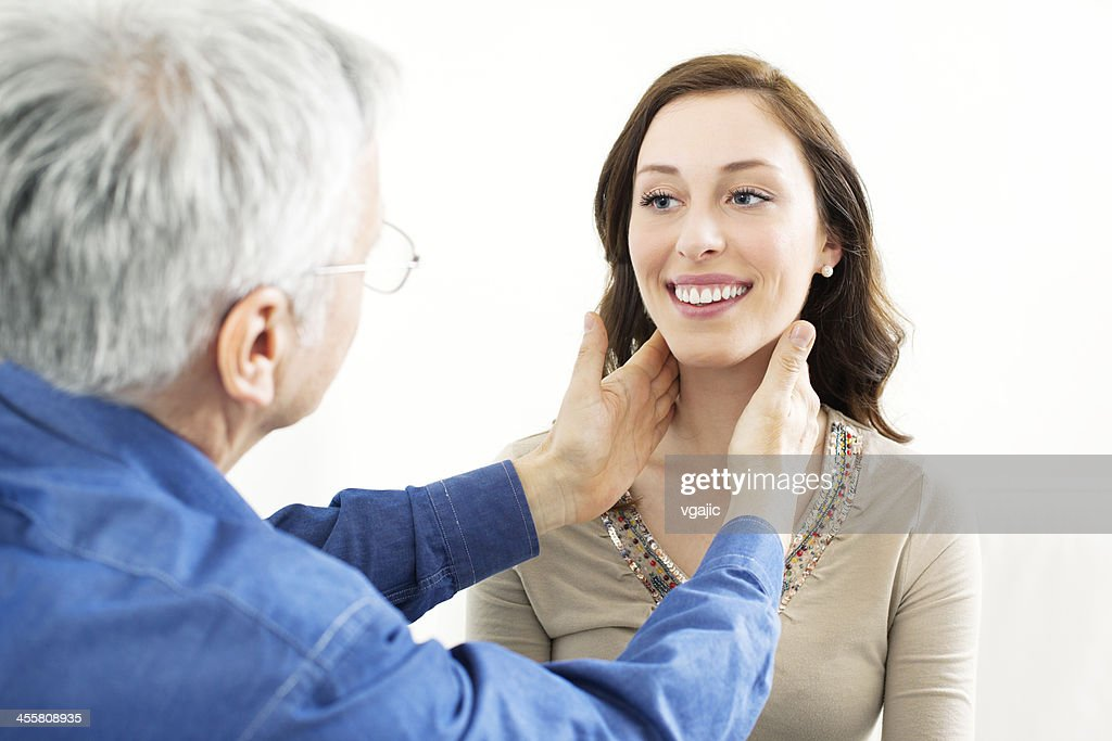 Male Doctor Checking Female Patient Glands : Stock Photo