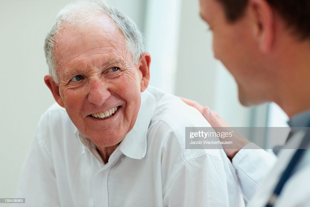 Male doctor discussing with his patient : Stock Photo