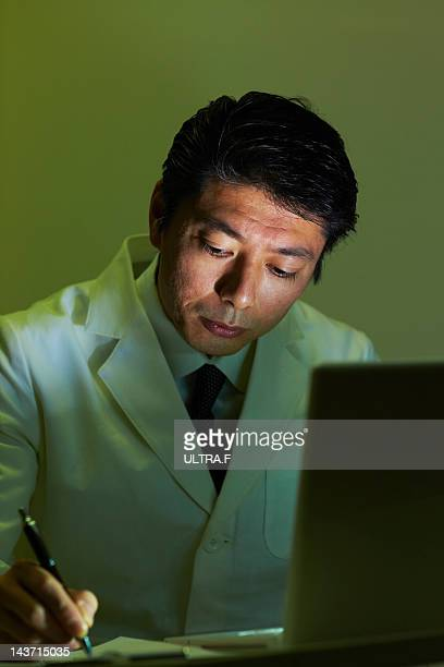Male doctor doing office work
