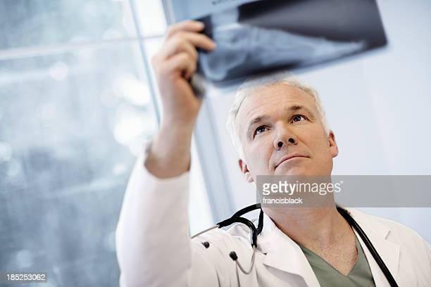 Male Doctor Examining An X-Ray Image