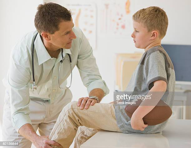 Male doctor examining boy