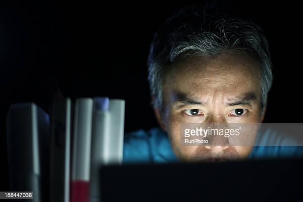 male doctor looking at laptop